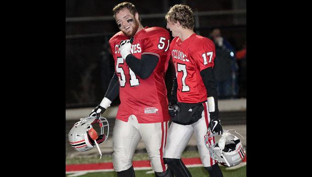 HCHS seniors Patrick Fah (51) and Kevin Campbell are all smiles after Friday's win.