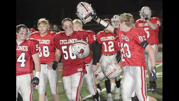 DOME BOUND -- Harlan Community players celebrate Friday night's 41-15 quarterfinal playoff win over Sergeant Bluff-Luton at Merrill Field. The victory clinched the Cyclones' first trip to the UNI-Dome since 2011. Left-right: Joey Arkfeld, Jacob Hansen, Caleb Brouse, Daniel Soll and Jake McLaughlin. (Photos by Mike Oeffner)