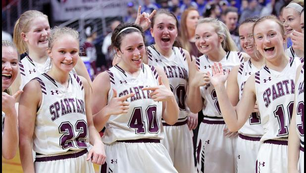 Exira-EHK players pose for the cameras following Wednesday's state tournament win over AGWSR.