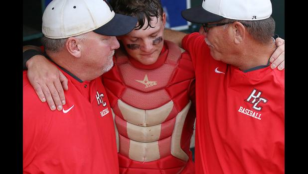 HCHS head coach Steve Daeges (right) and assistant coach Joe Heese console senior catcher Jared Moser following Saturday's championship game loss.