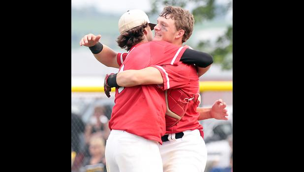 HCHS senior catcher Jared Moser (right) hugs junior pitcher Brett Sears following Wednesday's 6-0 substate final win over Winterset. Sears fired a four-hitter for his ninth win of the season.