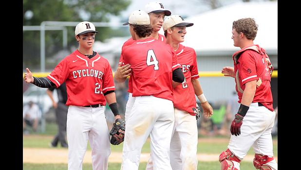 HCHS players, left-right, Luke Schaben, Brett Sears (4), Ryan Doran, Connor Bruck (2) and Jared Moser shake hands following Wednesday's substate win over Winterset.