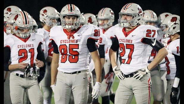 HCHS seniors Wyatt Schaben (27), Brady Wagner (85) and Jacob Bruck (21) react to Friday's playoff defeat at the hands of Lewis Central.