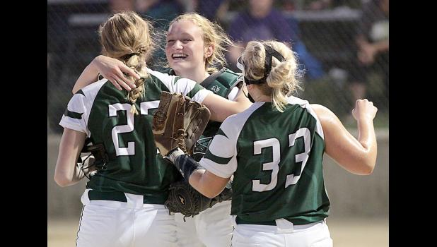 IKM-Manning catcher Shyanne Sporrer (center) celebrates the victory with Peyton Gross and Katelyn Crawford.