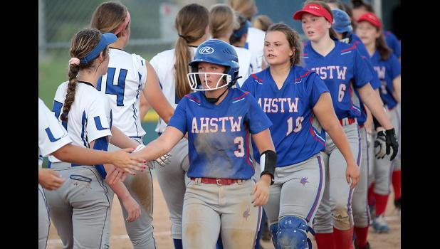 Paige Osweiler (3), Emma Jorgensen and Katie Anzalone (6) go through the postgame handshake line for AHSTW following its regional loss at Underwood.