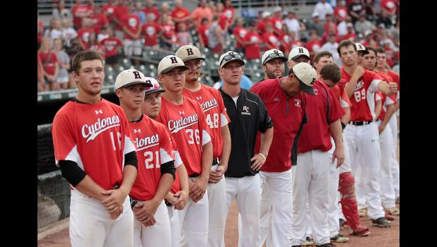 Harlan Community players and coaches line up on the field prior to their state tournament game against Oskaloosa on Tuesday night at Principal Park. (Photos by Mike Oeffner)
