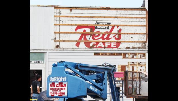 HARLAN -- As metal sheeting was taken away on the nail salon building, the old wooden sign of Red's Cafe, the popular breakfast stop for many Harlanites, was on display once again. The sign has since been covered up, but still remains as part of the building.