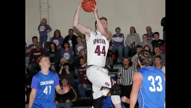 Exira-EHK senior Dakota Rold (44) grabs one of his 10 rebounds during the Spartans' 74-50 win over CAM on Monday night. The 10th-ranked Spartans improved to 16-2 overall. (Photo by Kim Wegener)