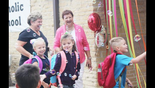 SCCS students and staff excited to head back to school include front L to R -- Josie Zimmerman, Edie Mae Kaufmann and Logan Erlbacher.  Back are Janet Zimmerman and teacher Cheryl Long.