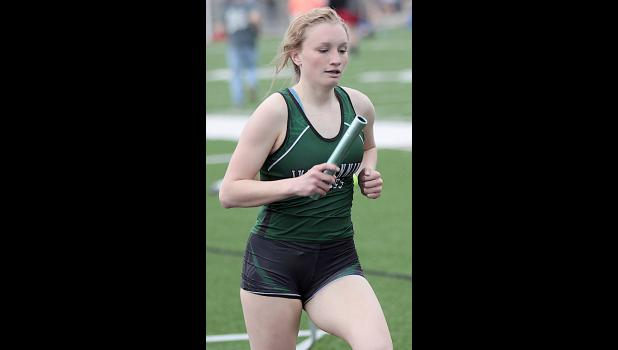 IKM-M senior Shyanne Sporrer runs a leg of the Wolves' second-place 4x800 relay.