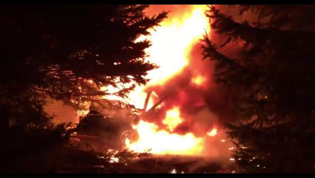 A Dodge Durango is shown on fire along Ridgeway Drive in Harlan.