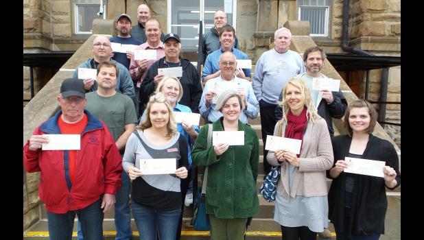 Nonprofit representatives receiving grant awards.