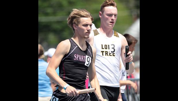 Senior Mason Rasmussen (left) runs the anchor leg of Exira-EHK's 14th-place 4x800 relay. (Photos by Mike Oeffner)