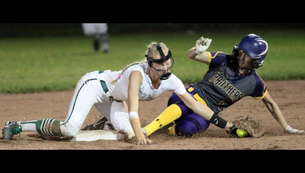 IKM-Manning second baseman Payton Sporrer (left) is unable to apply the tag as Logan-Magnolia's Kylan Straight steals second during Thursday night's WIC Softball Tournament championship game. The Panthers beat the Wolves 7-5.