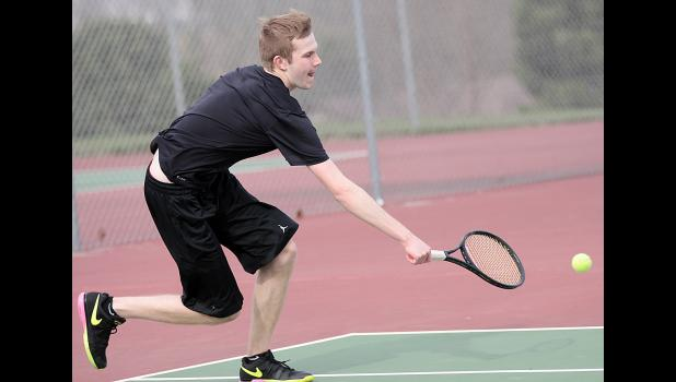 HCHS senior Isaac Stitz keeps a point alive during his 10-5 win over St. Albert's Reed Miller in No. 1 singles action Friday.