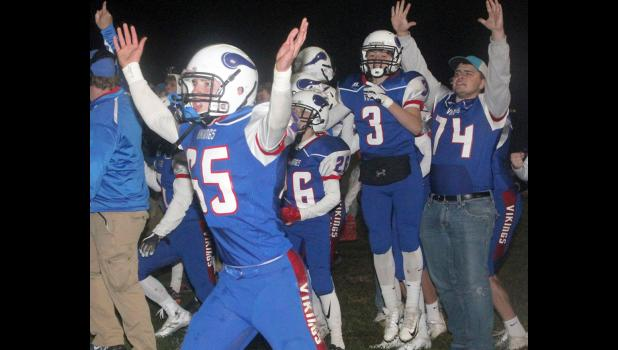 AHSTW senior Zach Stanton (left), along with teammates Hayden Fischer (26), Joel Sampson (3) and Brady Canada (74), celebrate the Vikings' first touchdown during last Friday's 30-28, three-overtime win against Alta-Aurelia. AHSTW, ranked second in Class A, improved to 10-0 and will host unranked Newman Catholic (8-2) in a quarterfinal playoff game Friday at 7:00 p.m. (Photos by Kim Wegener)
