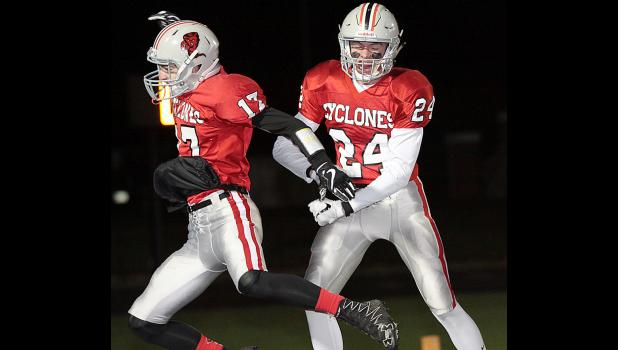 HCHS junior Eli Boldan (24) and senior Kevin Campbell celebrate Boldan's second-quarter touchdown reception during Friday's rout of Bishop Heelan. (Photos by Mike Oeffner)