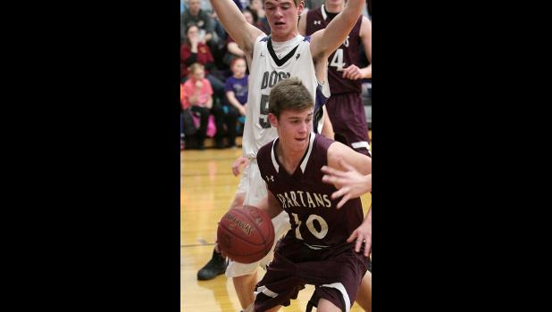 Spartan junior Trey Nelson works under the basket. (Photos by Mike Oeffner)