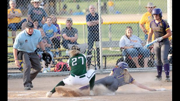 IKM-Manning pitcher Peyton Gross (27) tags out Logan-Magnolia's Reanna Rife at home plate for the third out of the fifth inning with the Wolves clinging to a 4-3 lead. Rife attempted to score on a pitch that got past catcher Zoey Melton, but Melton was able to get the ball to Gross for the tag. The Wolves won the game 8-7. (Photos by Mike Oeffner)