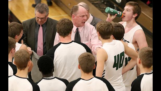 IKM-Manning coach Keith Wagner (middle) talks with his team during a timeout.