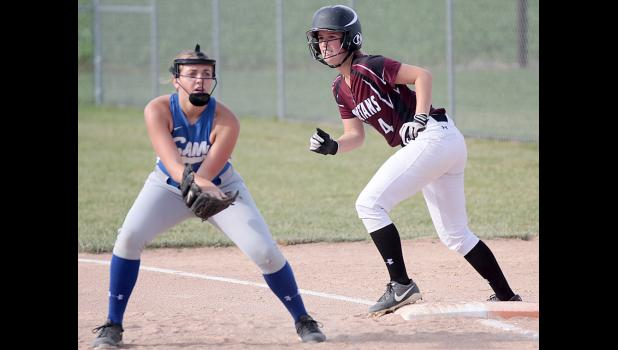 Spartan senior Rachel Walker (4) prepares to lead off first base during Monday's game.