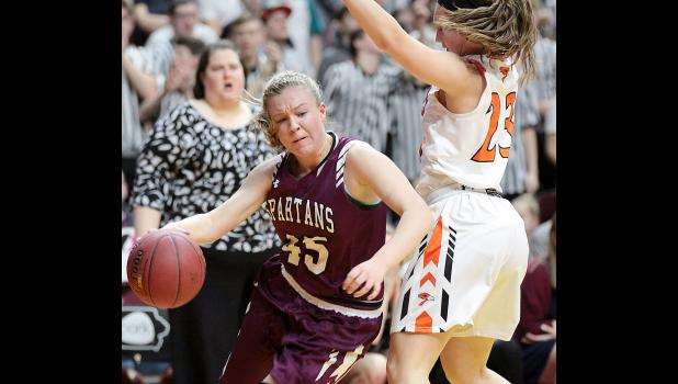 Exira-EHK sophomore Kamryn Waymire tries to drive baseline around Springville's Madi Wagaman during Friday's state semifinal.
