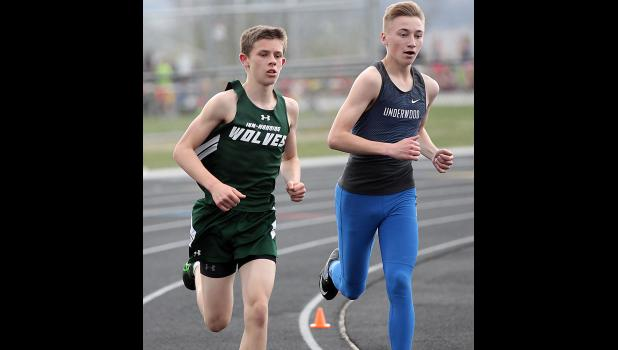 IKM-Manning's Quentin Dreyer (left) placed third in the 3,200-meter run (above) and fourth in the 1,600 with a new school record time of 4:49.54.