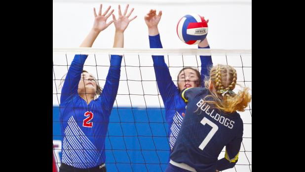 Riverside's Jadyn Achenbach (7) is blocked by AHSTW junior Kinsey Scheffler as Lady Vike sophomore Kailey Jones also defends the net during Thursday's Western Iowa Conference volleyball match.