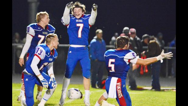AHSTW senior Ben Ehlers (7) celebrates Friday's playoff win over Newman Catholic alongside teammates Joey Cunningham (13), Caden Larson (70) and Brayton Tuma (5).