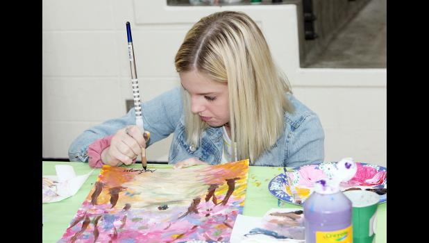 Abby Swanger of Carroll Kuemper High School works on a painting project
