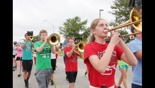 HARLAN -- Early August means fall camps, and the Harlan Community High School marching band students are no exception.  The band held its camp last week with musicians working on everything from parade marching to music and pre-game drill.  Above, the students march around town.  The band will have its first performance later this month.