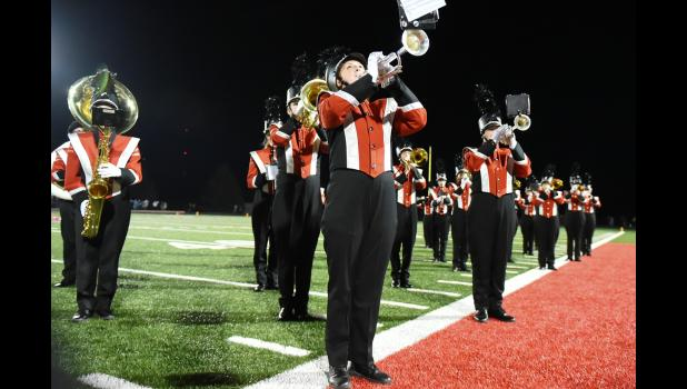 Performing at one of the football games this fall are Caitlin Bissen (front) and the rest of the band.  The HCHS Marching Band is gearing up for state contest Saturday.
