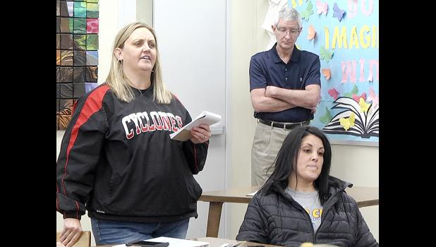Harlan citizen Allyson Bendorf addresses the school board Monday as Mandy Wagner, the wife of HCS Superintendent of Schools Justin Wagner, and Brian Gubbels, HCS Director of Finance, listen.  (