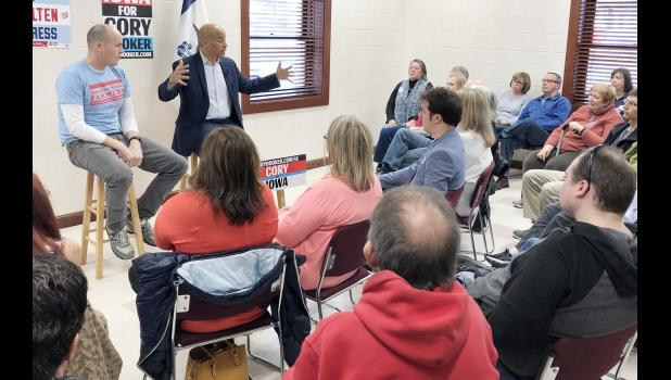 Scholten and Booker visit with the crowd at the town hall