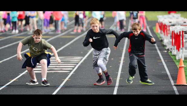 Tristan Harvey, Teagon Kasperbauer and Tyler Arkfeld compete in Friday's elementary track meet at Merrill Field.