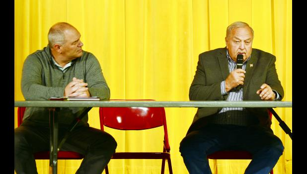 The only local contested race is for county supervisor as 16-year incumbent Roger Schmitz (right) is being challenged by newcomer Darin Haake.  Here the two discuss county issues at the forum.