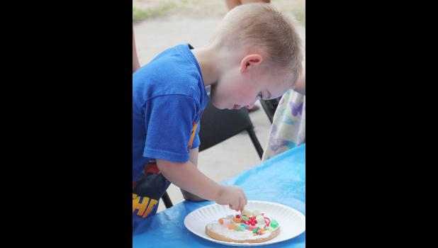 Jordan Andersen, Harlan, puts on the finishing touches to his cookie during the cooking decorating contest.