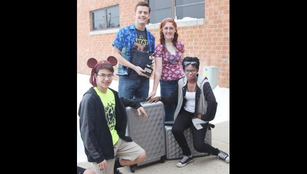 HCHS Music Students have their bags packed and are ready to take flight for sunny Orlando, FL and Disney World. Some of the students excited for the trip include at right, L to R -- freshman Jackson Lotenschtein, senior Fay Porter, junior Caitlin Bissen and sophomore Sirriniti Fleshman.