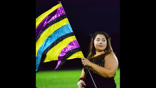 Adrian Zach performed at halftime with the flag corps.