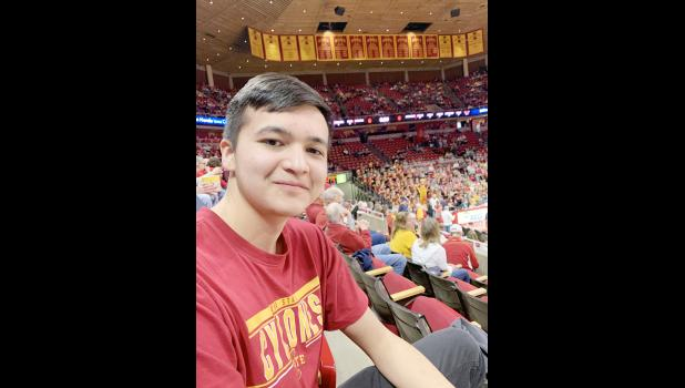 """Sarfaroz """"Oz"""" Sharipov of Tajikistan spent the past school year at HCHS. His host parents were Rick and Cheryl Chipman. Here Oz takes in an ISU basketball game in Ames."""
