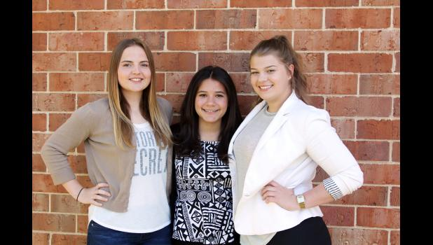 "From left: Leonie Finkbeiner, Alfonsina ""Bonlli"" de Santos Guzman and Anja Steiger have spent the past school year at HCHS as foreign exchange students. They will all be returning to their home countries soon. (Photo by Kim Wegener)"