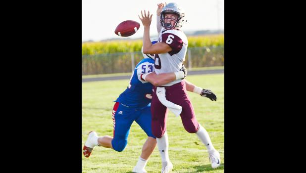 Shenandoah quarterback Kyle Cerven has the ball jarred loose by AHSTW junior defensive lineman Gavyn Fischer. Officials ruled an incomplete pass on the play.