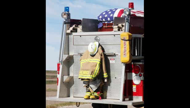The funeral processional for Earling Fire Chief Tom Henrich was held October 27 with his casket and fire gear being carried to the church cemetery aboard an Earling fire truck.  Henrich died while responding to a combine fire call near Earling October 20.