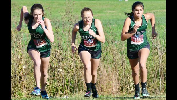 Left-right: IKM-Manning's McKenna Mullen, Emma Beermann and Macie Doyel compete in Thursday's 1A state qualifying meet.