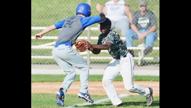 Amos Rasmussen of IKM-M tags out a Griswold base runner.