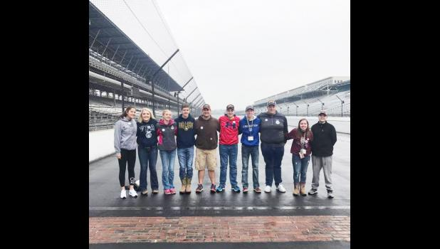 Harlan FFA members pictured at the Indianapolis Motor Speedway brickyard finish line.  It is a tradition for any racing champion to kiss the bricks after a victory at the speedway.  Harlan FFA members were able to kiss the bricks as well.  Pictured L to R are:  Jocelyn Mena, Abigail Jacobsen, Reanna Obrecht, Andrew Schechinger, Jack Buman, Nolan Blum, Brayton Schechinger, Alex Barrett, Hannah Tunender and Carter Wagner.  (Photo contributed)