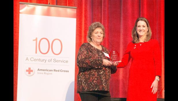 Monica Friedman, VP of Human Resources for Nationwide, presents Barb Jorgensen (left) with her award.  (Photo contributed)