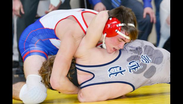 Viking junior Seth Kiesel turns Panorama's Emry Colby to his back during the 160-pound championship match. Kiesel won by fall to place first. (Photos by Bob Bjoin)