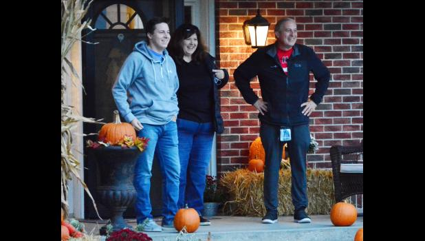 A very surprised Dr. Don, Laurel and Jack Klitgaard when the HCHS Marching Band showed up at their home for a special concert early Wednesday morning, Oct. 14.