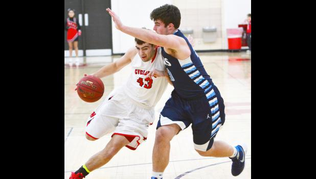 HCHS senior Will Lansman (43) drives to the basket on Lewis Central's Mitchell Brinkman.